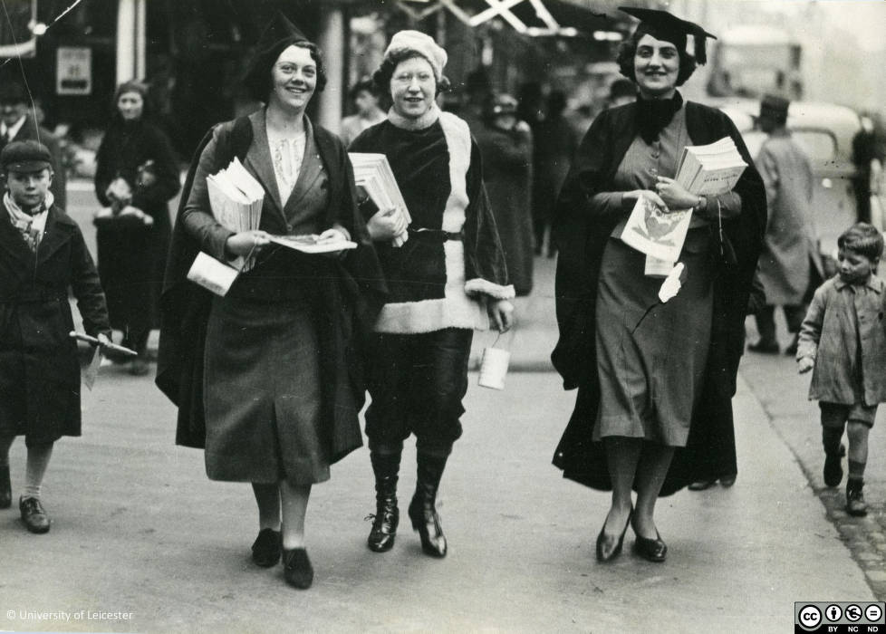 Black and white photograph of female students selling